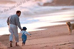 A good dad, walking the beach