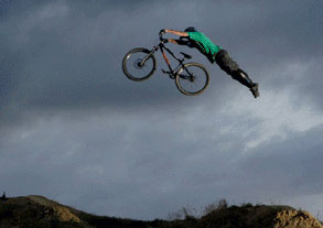 Man airborne with mountain bike