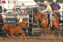 Rodeo cowboy demonstrates proper calf-roping technique