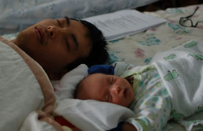 Peter & his infant son fast asleep